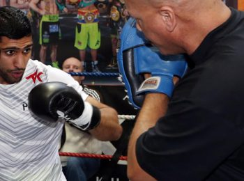 Boxing: Virgil Hunter expects Amir Khan to continue