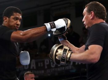 Anthony Joshua stands by Rob McCracken