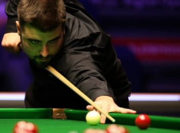 Jamie Clarke sees off Mark Allen